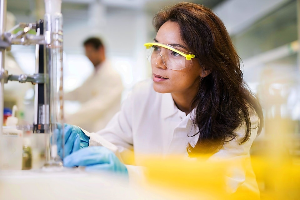Petrochemical catalyst analyst working inside a lab.