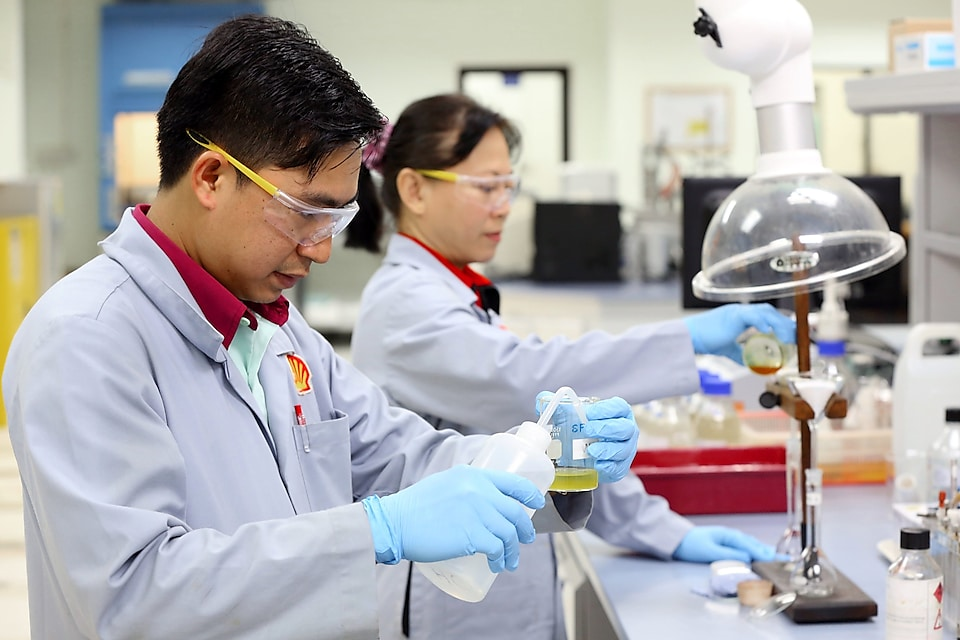 Lab technicians working in the Production Chemistry Lab