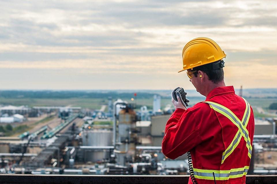 Sulphur recovery engineer overlooks the Shell plant near Alberta